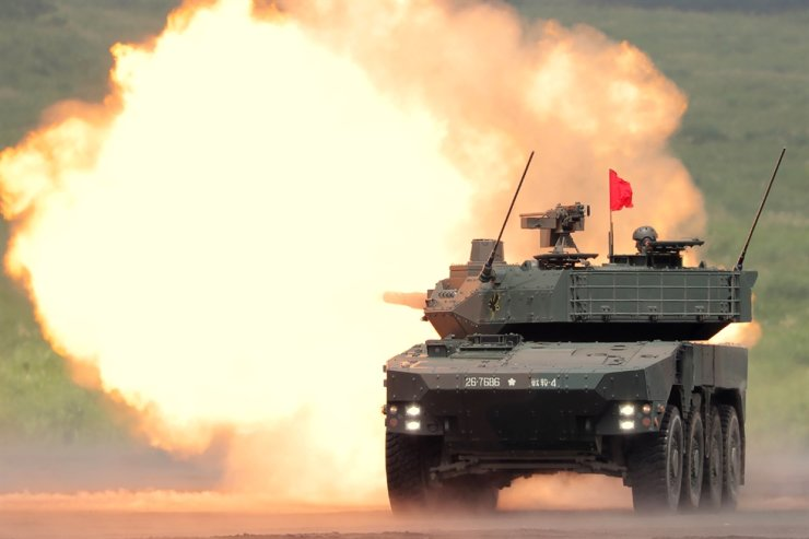 A Japan Ground Self-Defense Forces type-16 mobile combat vehicle fires during an annual live fire military exercise at the Higashi-Fuji firing range in Gotemba, at the foot of Mount Fuji in Shizuoka prefecture, in this Aug. 26, 2018, file photo. AFP