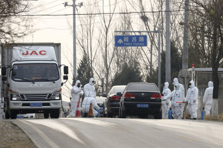 Workers disinfect passing vehicles in an area having the incident of African swine flu outbreak on the outskirts of Beijing, China, in this Nov. 23, 2018 file photo. / AP-Yonhap