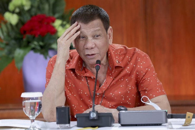 In this photo provided by the Malacanang Presidential Photographers Division, Philippine President Rodrigo Duterte attends a meeting at the Malacanang presidential palace in Manila, on Oct. 19, 2020. AP