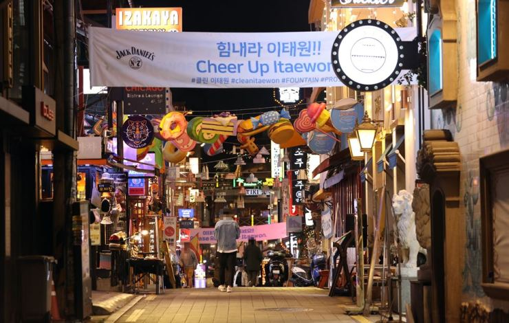 A street in Itaewon, a popular nightlife district in Seoul, remains quiet, Wednesday, three days before Halloween. Popular clubs in the district have decided to close over the weekend to help prevent the spread of COVID-19. Yonhap