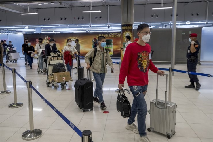 Chinese tourists from Shanghai arrive at Suvarnabhumi airport on a 'Special Tourist Visa,' in Bangkok, Tuesday, Oct 20, 2020. Thailand took a modest step toward reviving its coronavirus-battered tourist industry by welcoming 39 visitors who flew in from Shanghai, the first such arrival since normal traveler arrivals were banned almost seven months ago. AP