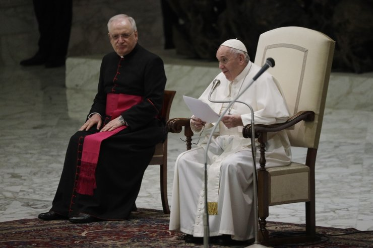 Pope Francis, right, delivers his message during his weekly general audience in the Paul VI hall at the Vatican, Wednesday, Oct. 21, 2020. Pope Francis endorsed same-sex civil unions for the first time as pope while being interviewed for the feature-length documentary 'Francesco,' which premiered Wednesday at the Rome Film Festival. AP