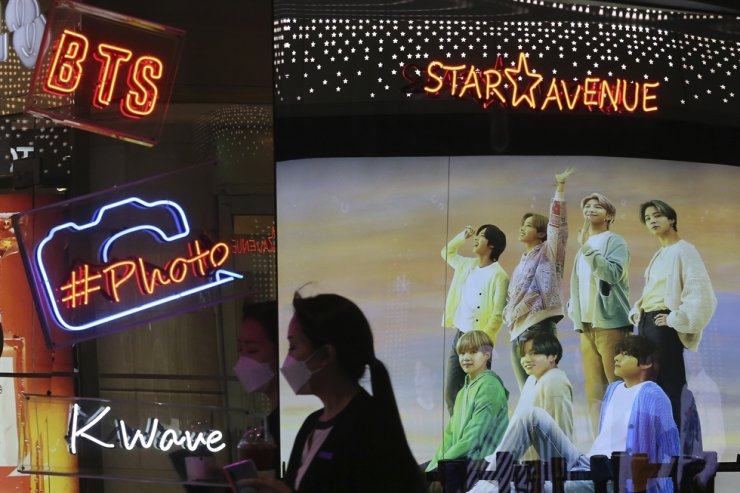 A photo of South Korean K-Pop group BTS is seen through a window of a duty free shop in Seoul, Oct. 14. Chinese nationalists erupted in anger at BTS after its leader thanked Korean War veterans for their sacrifices. AP-Yonhap