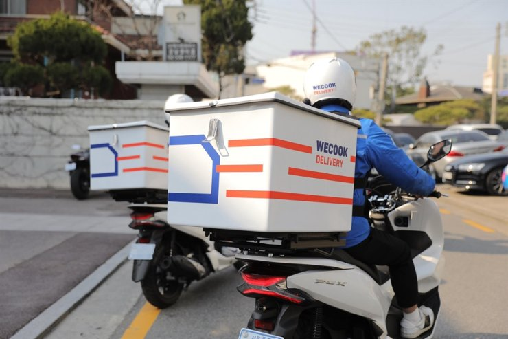 Deliverymen at work / Korea Times file