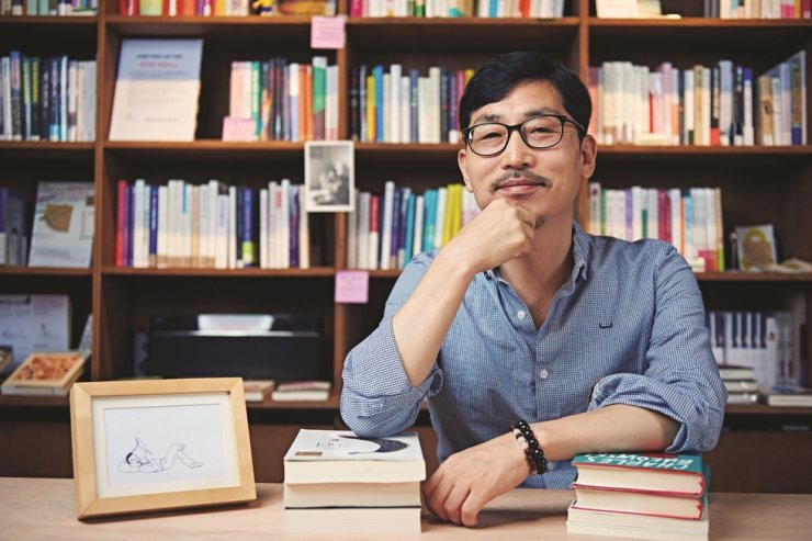 Nho Myung-woo, a sociology professor at Ajou University and owner of Bookshop Nieun, poses at his bookstore in Seoul in this undated photo. / Courtesy of KL Publishing