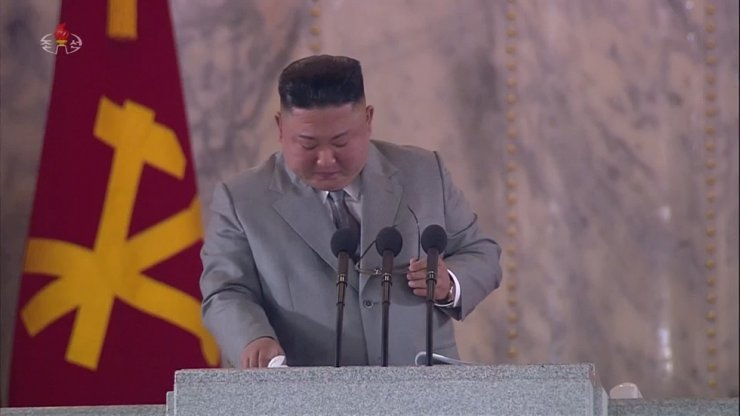 North Korean leader Kim Jong-un becomes emotional and takes off his glasses to wipe away his tears during a speech at an event to mark the 75th anniversary of the founding of the Workers' Party of Korea, Saturday. Yonhap