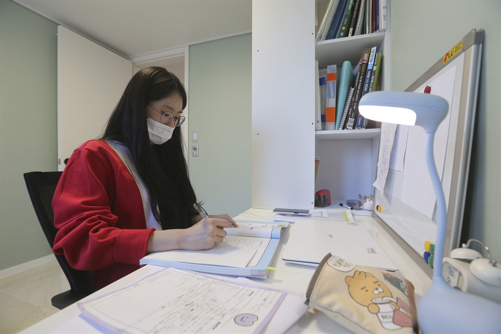 Han Shin-bi, a high school senior in Seoul, wearing a face mask speaks during an interview in Seoul, Sept. 18, 2020. Experts say the reduced interaction with teachers, digital distractions and technical difficulties are widening the education achievement gap among students in Korea, leaving those less well off, like Han, at even more at a disadvantage. AP