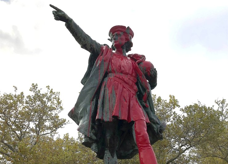 Red paint covers a statue of Christopher Columbus on Oct. 14, 2019, in Providence, Rhode Island, after the statue was vandalized on the day named to honor Columbus as one of the first Europeans to reach the New World. The statue has been the target of vandals on Columbus Day. AP