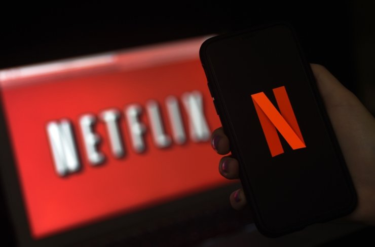 In this file illustration photo taken on March 31, 2020, a computer screen and mobile phone display the Netflix logo in Arlington, Virginia. AFP