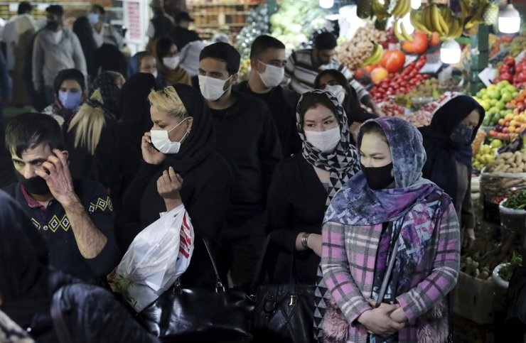 People wearing protective face masks are seen in the Tajrish traditional bazaar in northern Tehran, Iran, Thursday, Oct. 15, 2020. A young woman has been arrested in Iran after a video appeared to show her cycling without a veil. AP