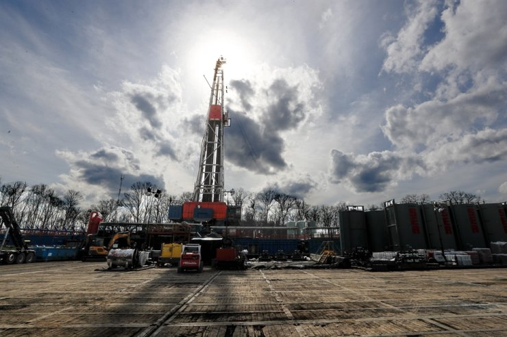 In this March 12, 2020, file photo, the sun shines through clouds above a shale gas drilling site in St. Mary's, Pa. In a late gambit to win the battleground state of Pennsylvania, U.S. President Donald Trump and his GOP allies have intensified attacks on Joe Biden over fracking, hoping to drive a wedge between the former vice president and the white, working-class voters tied to the state's booming natural gas industry. AP