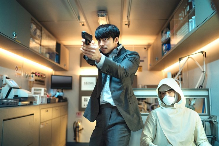 Actors Gong Yoo, left, and Park Bo-gum in a scene from sci-fi action film 'Seobok' Courtesy of CJ Entertainment