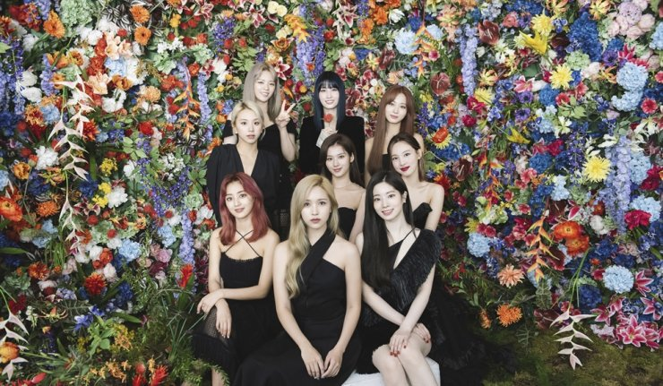 This August photo released by JYP Entertainment shows a K-pop girl group TWICE in Seoul. TWICE, a popular group known for its catchy lyrics and colorful aesthetics, released its second full album, a collection that invites listeners into the band's more daring side. JYP Entertainment via AP