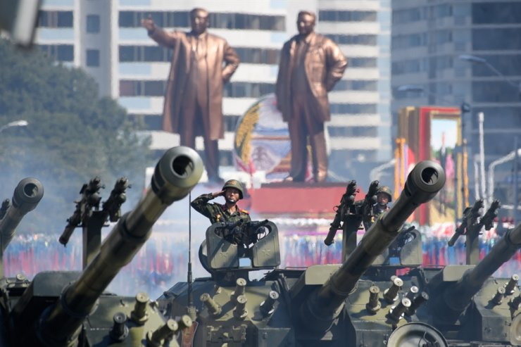 In a file photo taken on September 9, 2018 Korean People's Army (KPA) soldiers salute as they ride tanks during a military parade and mass rally on Kim Il Sung square in Pyongyang. AFP-Yonhap