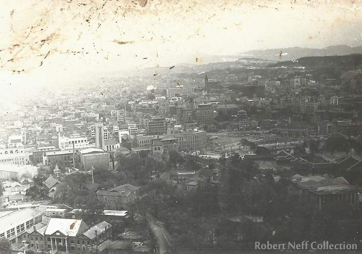 The Jeongdong area as seen from a helicopter in 1960. The former Russian legation's white tower can be seen in the center-left. Robert Neff Collection
