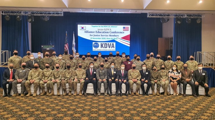 Participants at the 2020 KDVA Alliance Education Conference for Junior Service Members, hosted by the Korea Defense Veterans Association (KDVA) Korea Chapter, post for a photo at the at the Osan Air Base, Gyeonggi Province, Thursday. /Courtesy of KDVA
