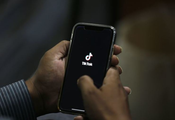 In this July 21, 2020, file photo, a man opens social media app 'TikTok' on his cell phone, in Islamabad, Pakistan. India banned 43 more Chinese apps on Nov. 24, saying they threatened its 'sovereignty and integrity' as tensions remain high between the two countries following a deadly border clash. AP