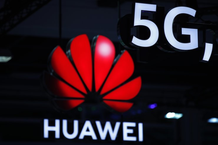 In this file photo taken on Oct. 15, 2019, Huawei and 5G signs are on display during the 10th Global mobile broadband forum hosted by Chinese tech giant Huawei in Zurich. AFP