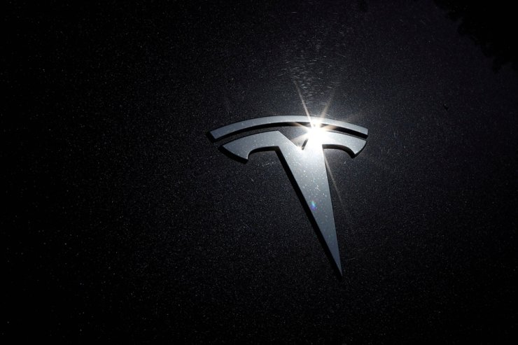 The Tesla logo is seen on a car in Los Angeles, July 9, 2020. Reuters