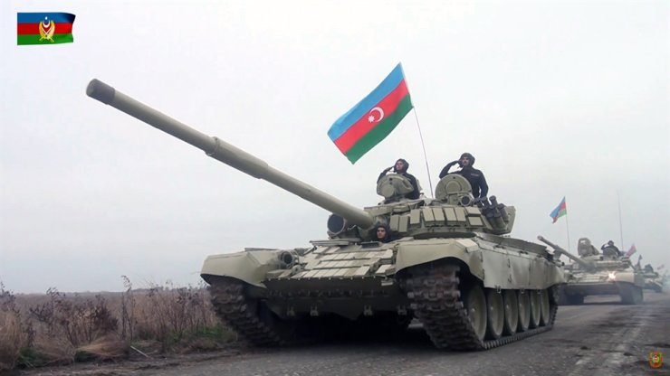 A handout still image taken from video footage released Nov. 20, by the press service of the Azerbaijan Defense Ministry shows Azerbaijani tanks moving along a road in the Aghdam region, Azerbaijan. EPA
