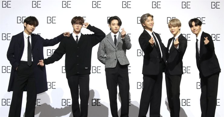 BTS members pose before a media conference at the Dongdaemun Design Plaza in Seoul, Friday. Yonhap