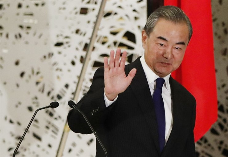 China' Foreign Minister Wang Yi waves after a press briefing in Tokyo on Tuesday, Nov. 24, 2020. AP
