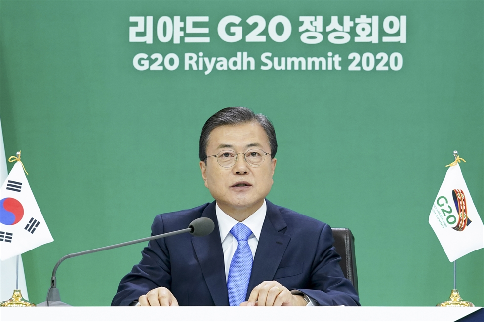 South Korean President Moon Jae-in and his aides enter a makeshift video conferencing room for the G20 Riyadh Summit 2020 prepared inside Cheong Wa Dae on Nov. 21. Yonhap