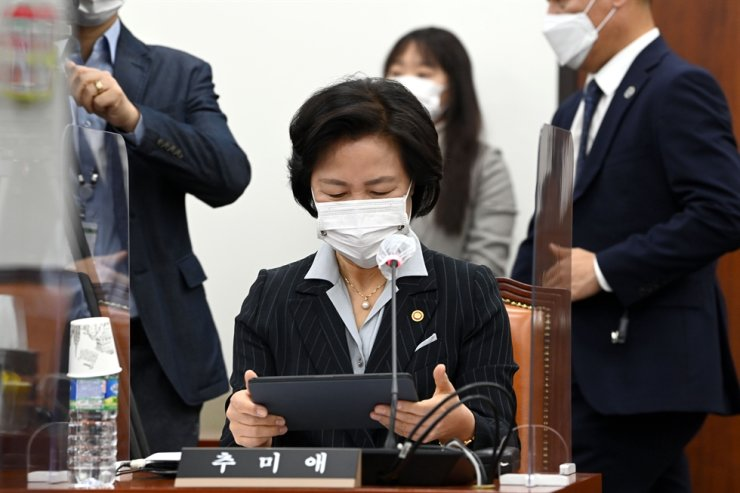 Justice Minister Choo Mi-ae looks at material ahead of a meeting at the National Assembly, Friday. / Yonhap