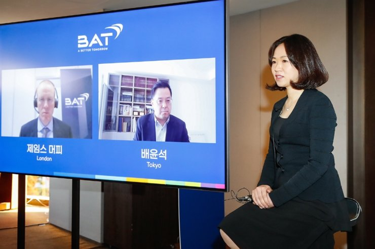 British American Tobacco (BAT) Korea Country Manager Kim Eun-ji, right, speaks during the company's press conference on research into the risks of tobacco-heating products at the Plaza Hotel in Seoul, Thursday. BAT's Group Head of Potentially Reduced Risk Product Sciences James Murphy, left on screen, and the firm's North Asia Area Legal and External Affairs Head Bae Yoon-suk joined the conference online. Courtesy of BAT Korea