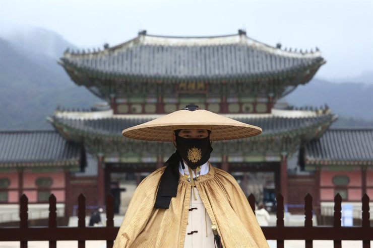 An Imperial guard wearing a face mask stands outside the Gyeongbok Palace in Seoul, Thursday, Nov. 19, 2020. AP