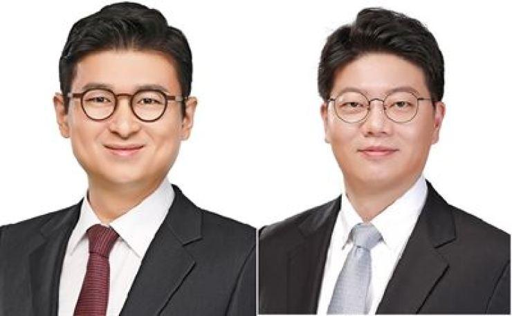 Lee Kang-wook, left, and Im Jang-gyun