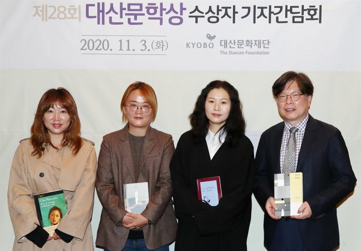 The winners of the Daesan Literary Awards are, from left, translator Joo Ha-sun for her Spanish translation of the book 'Kim Ji-young, Nacida en 1982'; novelist Kim Hye-jin for 'Worker No. 9'; poet Kim Haeng-sook for her poetry book 'Are Your Running Errands'; and literature critic Yoo Sung-ho for his book 'Art of Lyricism' at the Gwanghwamun Kyobo Building in Seoul, Tuesday. Yonhap