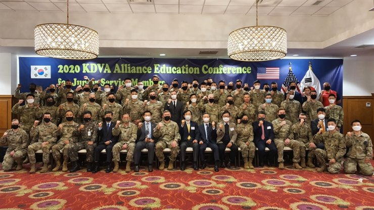 Members of the Korea Defense Veterans Association (KDVA) Korea Chapter, an association of U.S. veterans who served in Korea as members of the United States Forces Korea (USFK), pose for a photo together with current USFK service members during a conference hosted by the KDVA at U.S. Army Garrison Humphreys in Pyeongtaek, Gyeonggi Province, Nov. 6, to help junior USFK service members better understand the importance of the alliance between the countries. Courtesy of KDVA