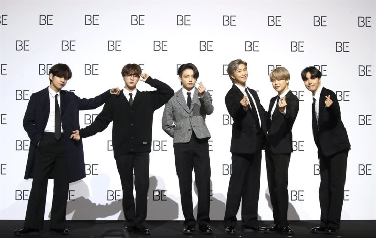BTS members pose during a media conference for their latest album 'BE (Deluxe Edition)' at Dongdaemun Design Plaza in Seoul, Friday. / Yonhap