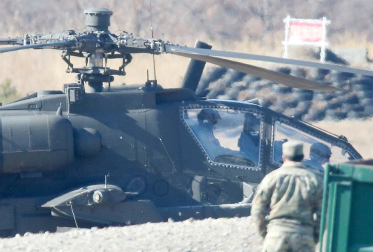 An Apache helicopter prepares for take-off at a firing range in Pohang, North Gyeongsang Province, in this Feb. 13 photo. / Yonhap