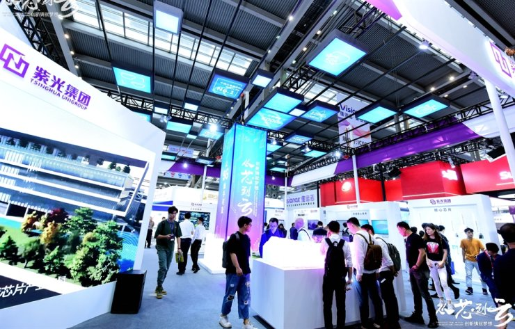 Visitors look around Tsinghua Unigroup's booth installed at the China Information Technology Expo in Shenzhen, China, in this April 2019 photo. / Captured from Tsinghua Unigroup webpage
