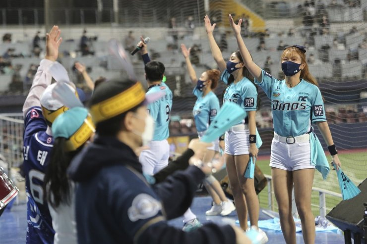 Cheerleaders wearing face masks perform during Game 6 of the Korean Series between the Doosan Bears and the NC Dinos at Gocheok Sky Dome in Seoul, Tuesday, Nov. 24, 2020. AP