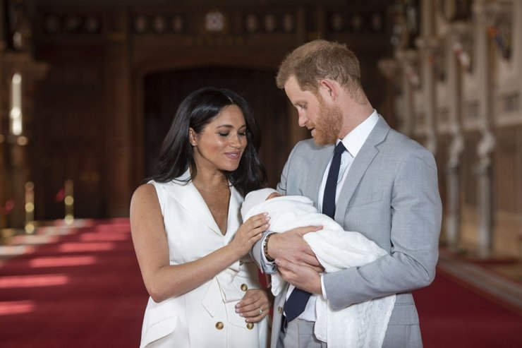 In this Wednesday May 8, 2019 file photo Britain's Prince Harry and Meghan, Duchess of Sussex, pose during a photocall with their newborn son Archie, in St George's Hall at Windsor Castle, Windsor, south England. AP-Yonhap