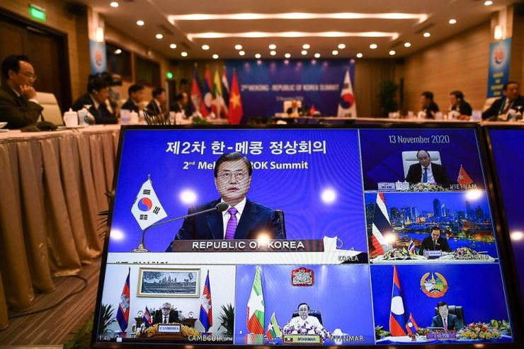 South Korean President Moon Jae-in (left on screen) addresses counterparts at the 2nd Mekong - South Korea Summit of the Association of Southeast Asian Nations (ASEAN), on a live video conference held online due to the COVID-19 coronavirus pandemic, in Hanoi. AP-Yonhap