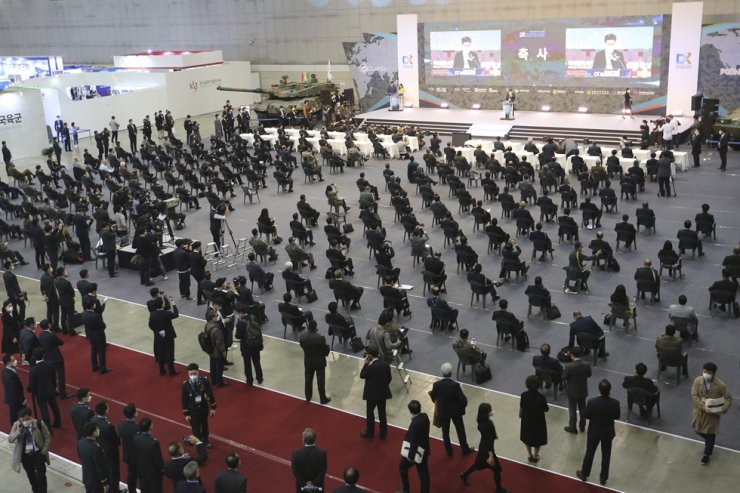 Attendees sit while maintaining social distancing as they listen to a speech of Defense Minister Suh Wook during a defense expo, DX Korea 2020, in Goyang, Wednesday, Nov. 18, 2020. AP