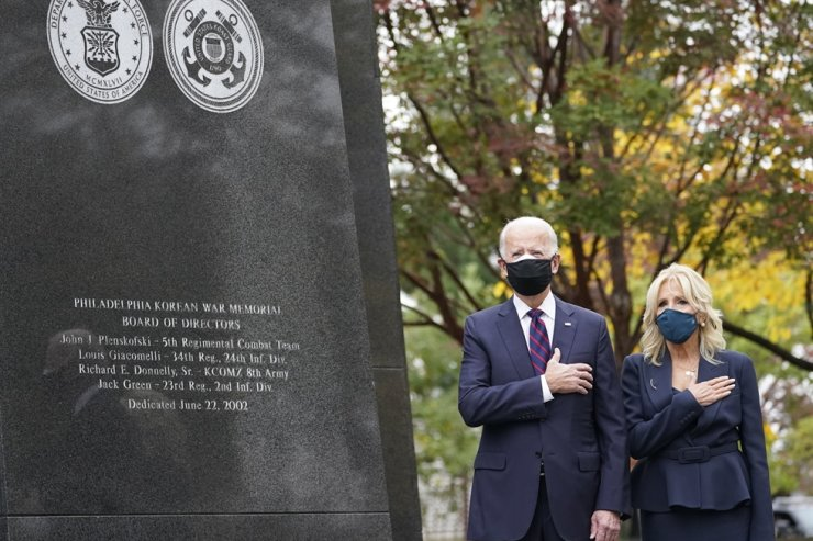 U.S. President-elect Joe Biden and his wife Jill Biden attend a service at the Philadelphia Korean War Memorial at Penn's Landing on Veterans Day, Wednesday, Nov. 11, 2020. AP