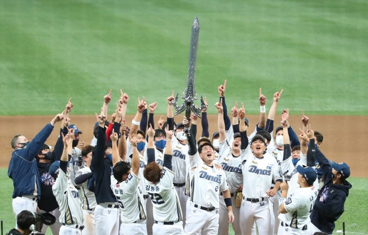 NC Dinos' players celebrate after winning the Korean baseball championship by beating the Doosan Bears 4-2 in Game 6 of the Korea Series at the Gocheok Sky Dome in Seoul, Tuesday. Yonhap