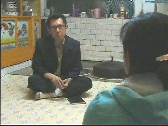 A scene from 'North Korea VJ' (2011) directed by journalist Jiro Ishimaru showing a 23-year-old North Korean woman named Hyang-ran. Courtesy of ASIAPRESS