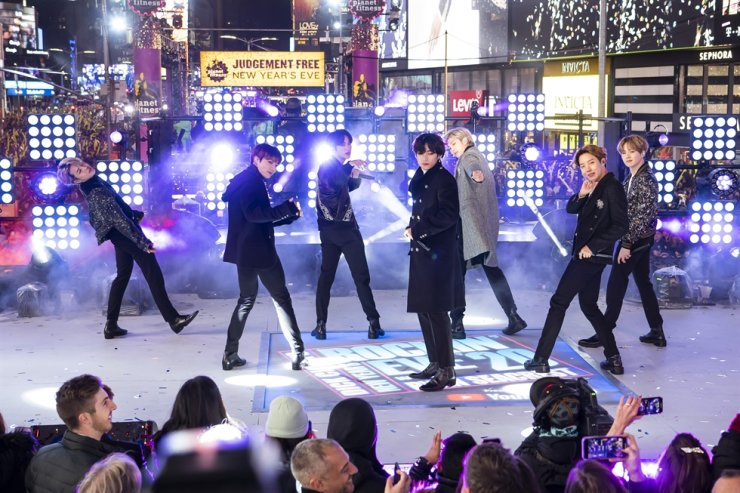 Members of BTS perform at the Times Square New Year's Eve celebration in New York on Dec. 31, 2019. The K-pop band is nominated for a Grammy Award for best pop duo/group performance with 'Dynamite,' their first song to hit the No. 1 spot on the Billboard Hot 100 chart. AP