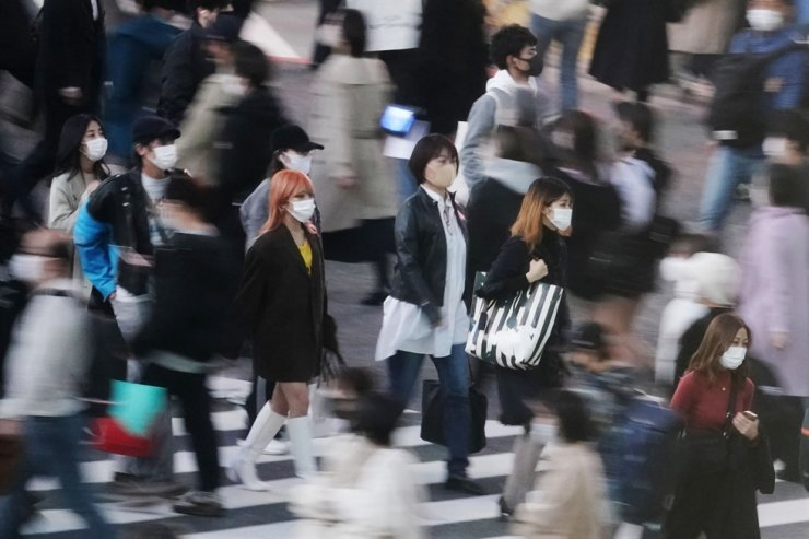 People across the Shibuya scramble crossing in Tokyo, Nov. 21. Japan is scaling back on the government-backed 'GoTo' campaign to encourage travel and dining out, as the number of confirmed COVID-19 cases reached a record for the fourth day straight, Nov. 22. AP