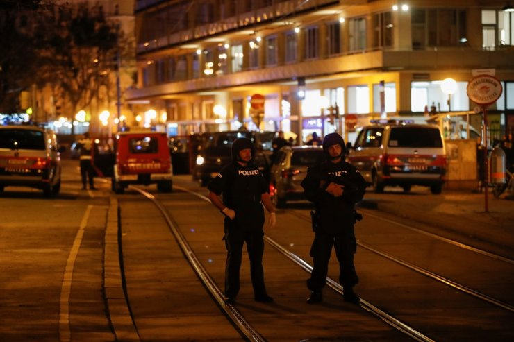Police officers block a street after exchanges of gunfire in Vienna, Austria, Nov. 2, 2020. Reuters