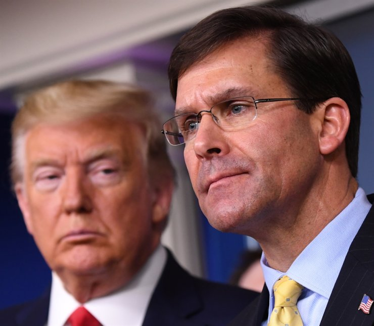 Secretary of Defense Mark Esper (R) delivers remarks on the COVID-19 pandemic as US President Donald J. Trump looks on in the Brady Press Briefing Room at the White House in Washington, DC, USA, 18 March 2020 (Reissued 09 November 2020). EPA-Yonhap