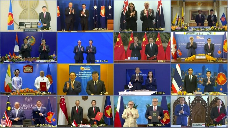 This image made from a teleconference provided by the Vietnam News Agency shows the leaders and trade ministers of 15 Regional Comprehensive Economic Partnership countries pose for a virtual group photo in Hanoi, Vietnam, Sunday, Nov. 15, 2020. China and 14 other countries have agreed to set up the world's largest trading bloc, encompassing nearly a third of all economic activity, in a deal many in Asia are hoping will help hasten a recovery from the shocks of the pandemic. AP
