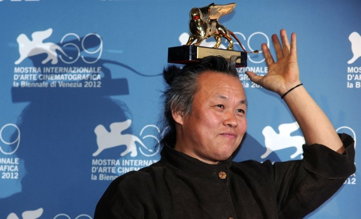 Kim Ki-Duk holds the Golden Lion for best movie on his head during a photocall following the award ceremony during the 69th Venice Film Festival at the Venice Lido in this file photo taken Sept. 8, 2012. AFP