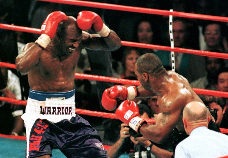 In this June 28, 1997, file photo, Evander Holyfield, left, reacts after Mike Tyson bit his ear during the third round of their WBA heavyweight championship fight in Las Vegas. Reuters